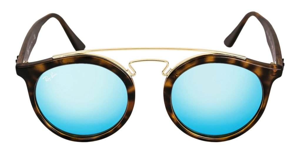 A pair of tortoise Ray-Ban sunglasses with blue lenses.