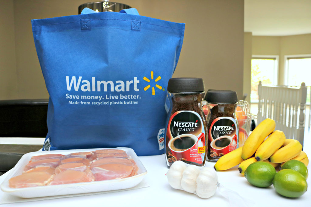 A Walmart bag is filled with groceries and the groceries are being unpacked, Nescafé Clásico is shown among the groceries.