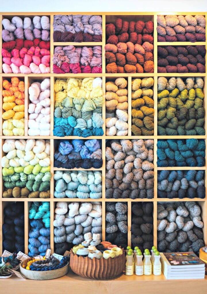 Wall of yarn balls in every colour.