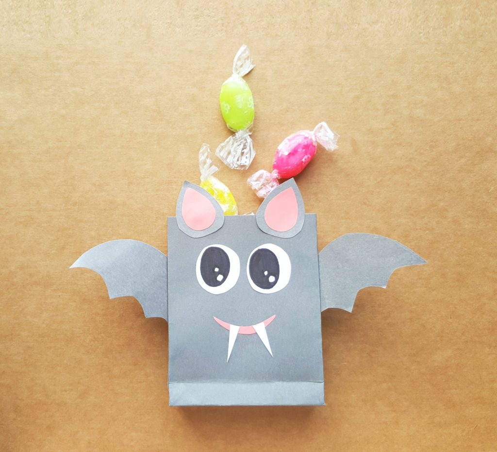 Cute grey bat treat bag with hard candies.