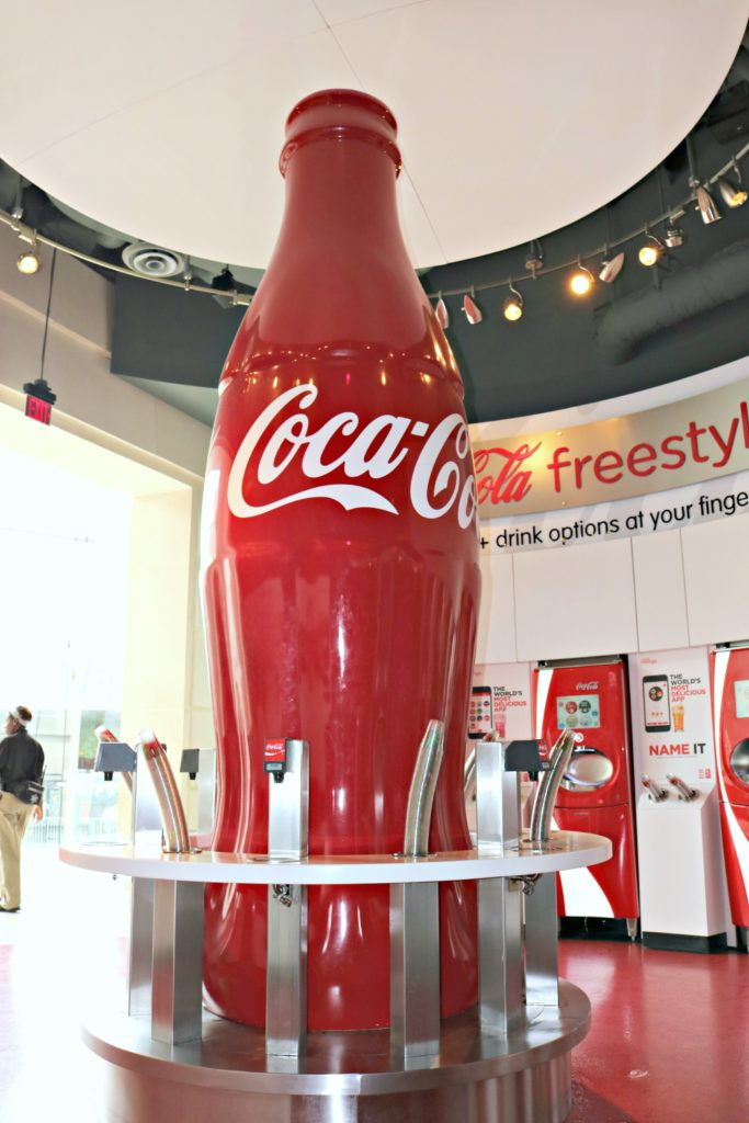 Huge Coca-Cola bottle and pop machines for all you can drink at Coca-Cola.