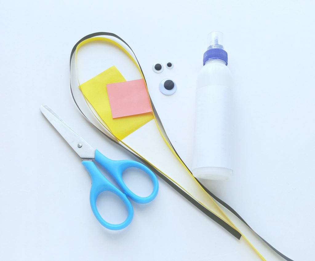 A group of supplies like glue, scissors, paper, and googly eyes are shown.