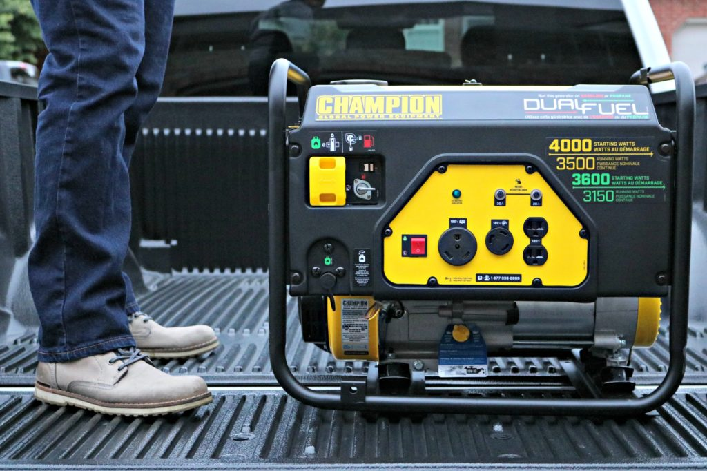 Champion generator being placed into a truck bed.