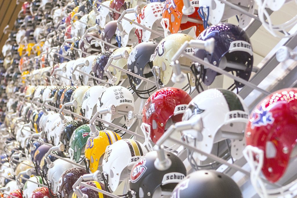 College football helmets are shown close up.