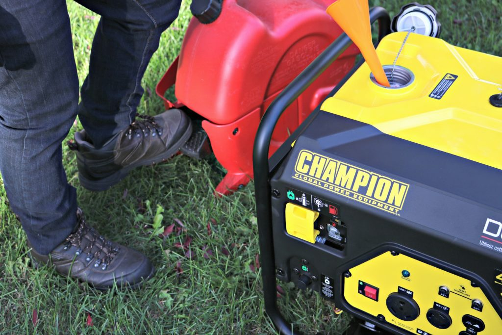 A man puts gas in his Champion generator.