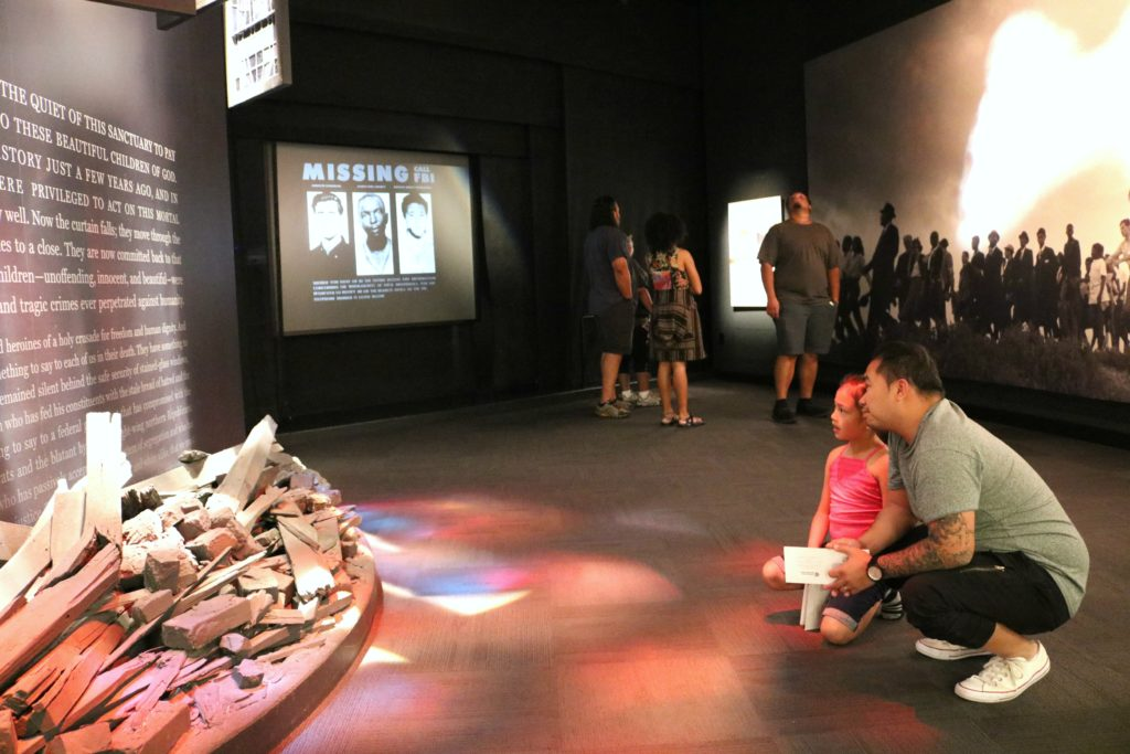 A little girl and her dad learn about the three little girls who lost their lives due to a bombing.