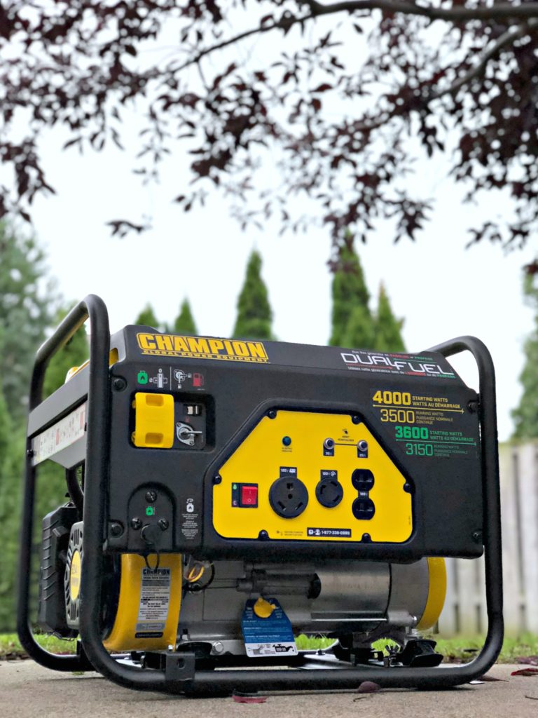 A Champion generator stands tall in a back yard.