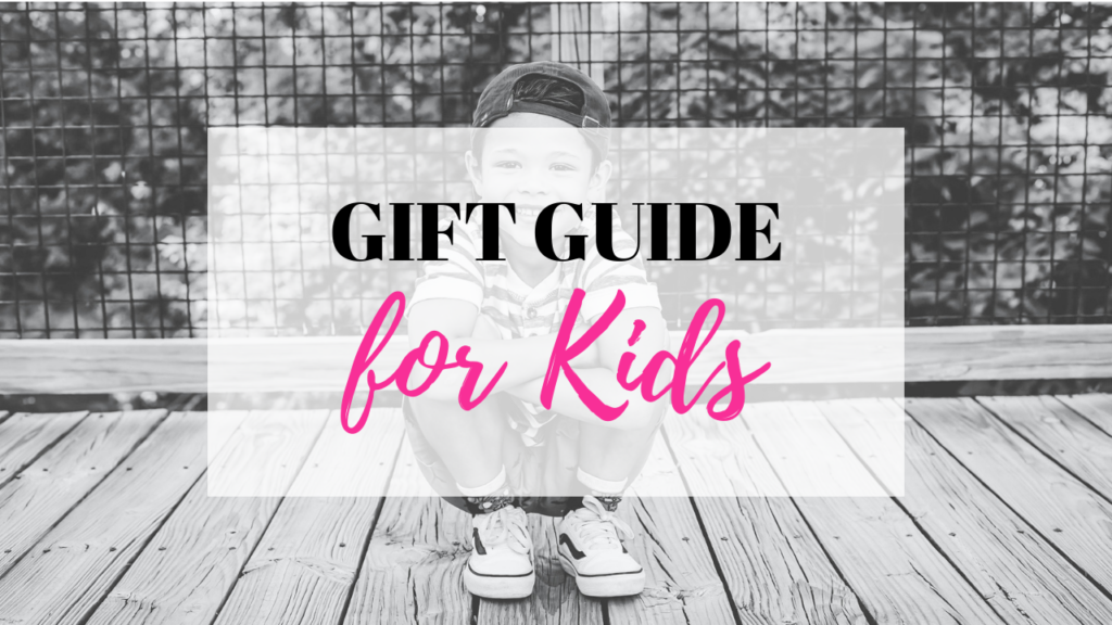 Gift Guide for Kids is displayed over a little boy crouched down playfully.