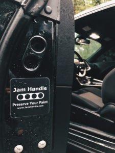 Dodge Challenger with door ajar showing off Jam Handle and Jam Handle sticker.