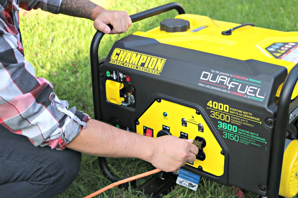 Darasak plugs into a generator after having filled it with gas.