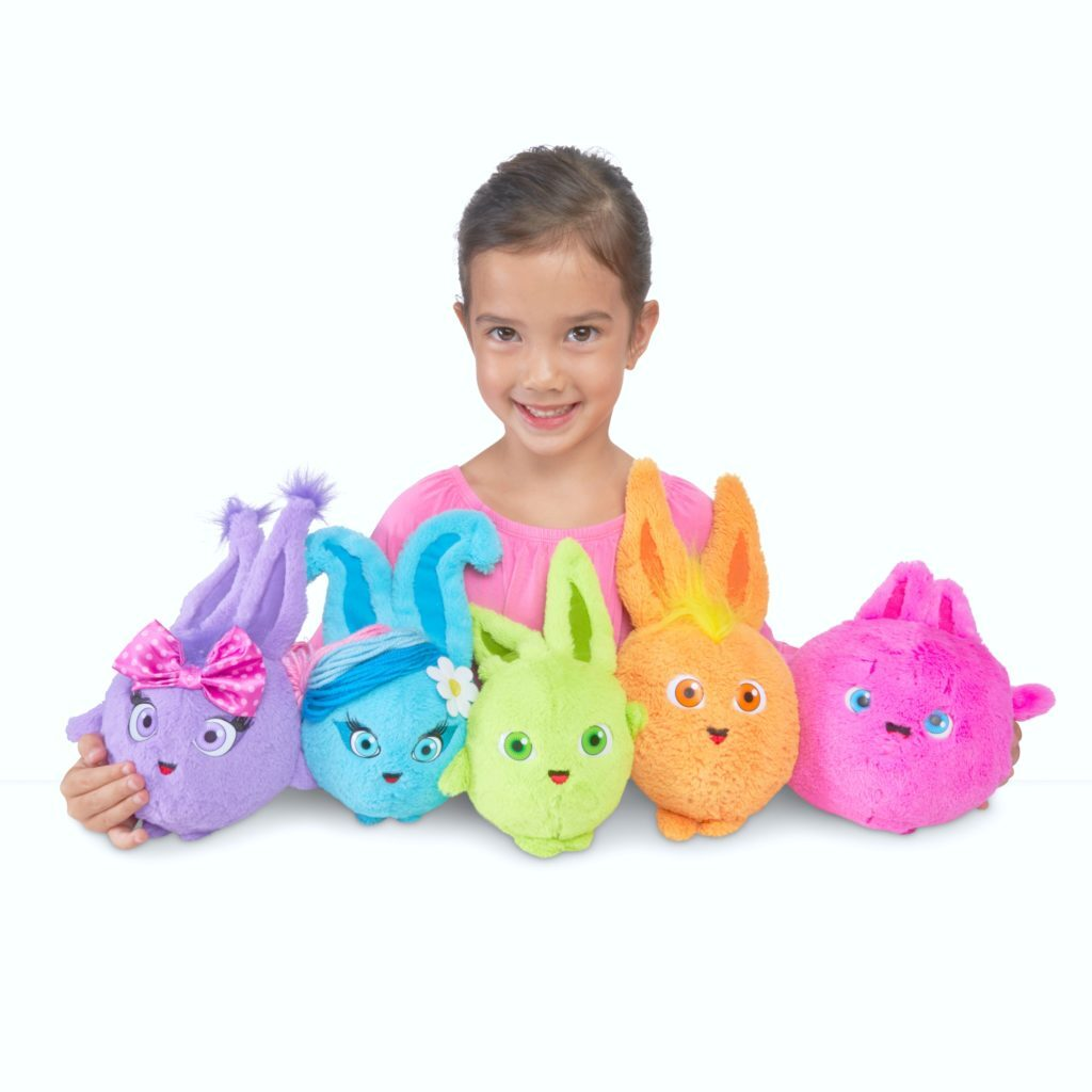 Little girl with Sunny Bunnies in her lap.