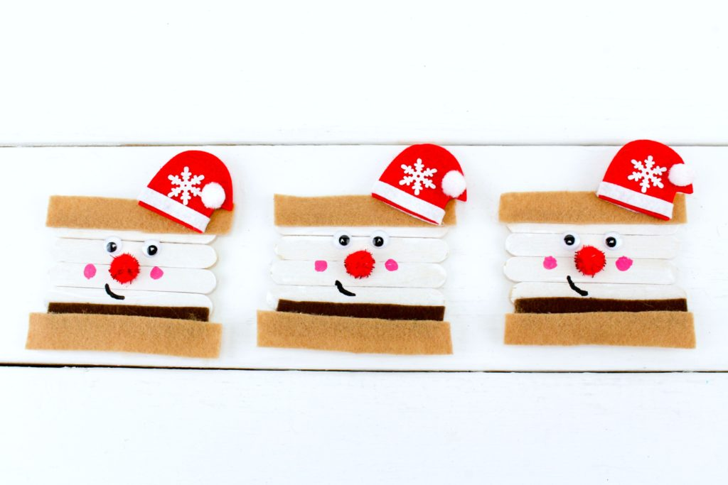 White shiplap background with cute Santa S'mores ornament.