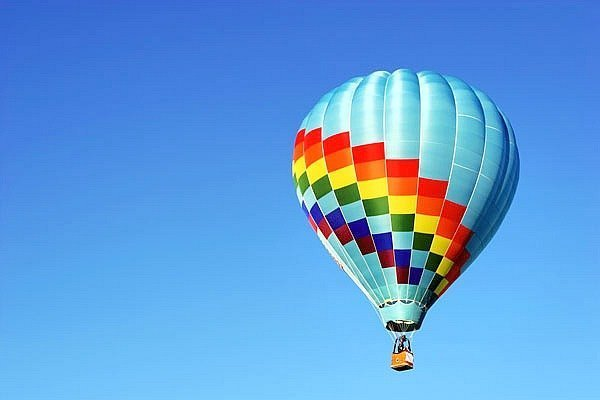 A hot air balloon against a blue sky.