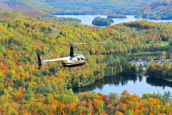 A helicopter flies over Mont Tremblant during the fall.