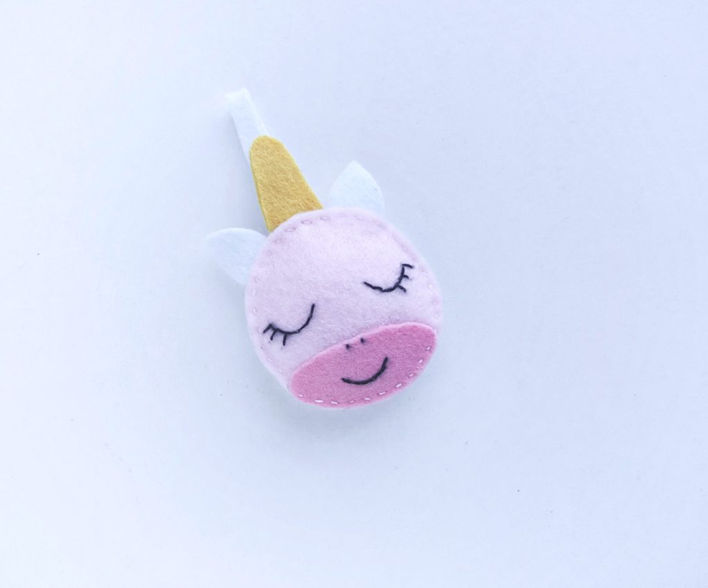 The felt unicorn ornament is sewed fully.