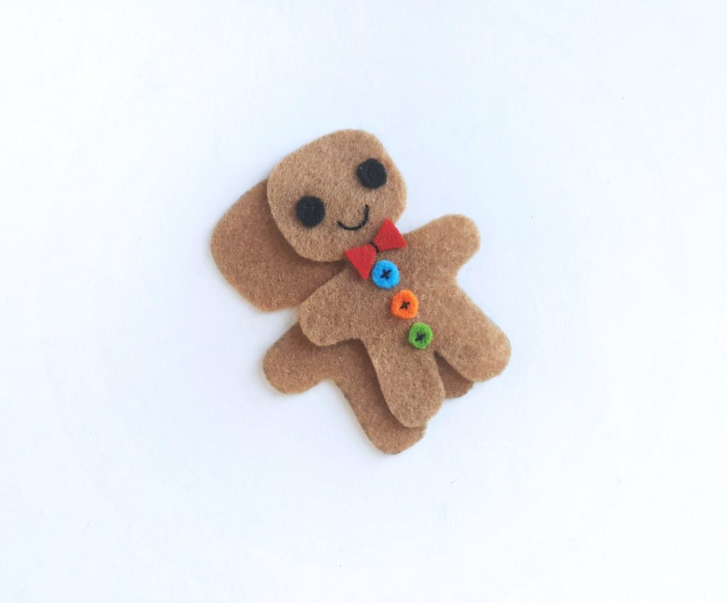 Time to sew both gingerbread man cutouts together before stuffing.