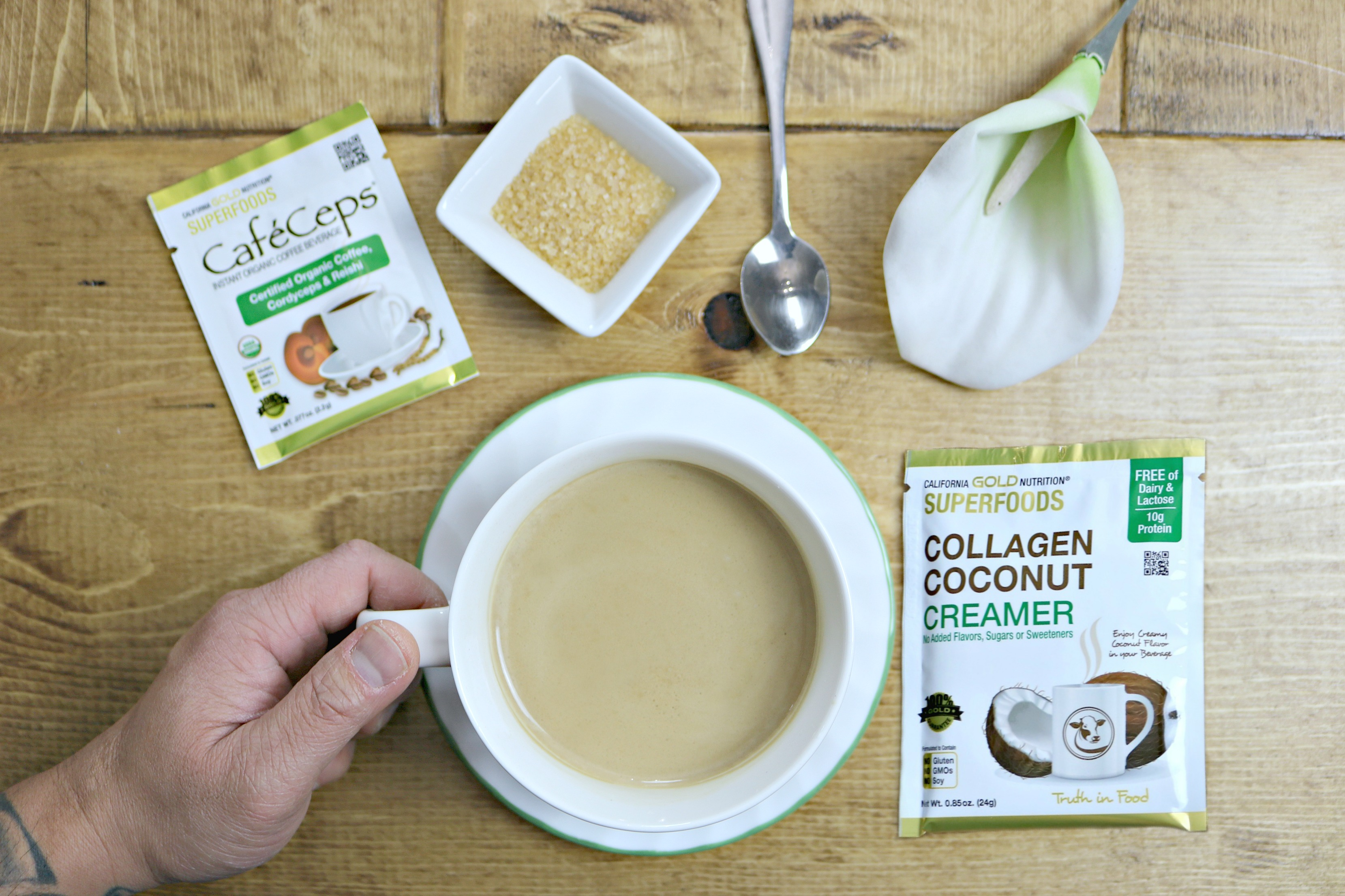 Cup of coffee with collagen coconut creamer and collagen and reishi.