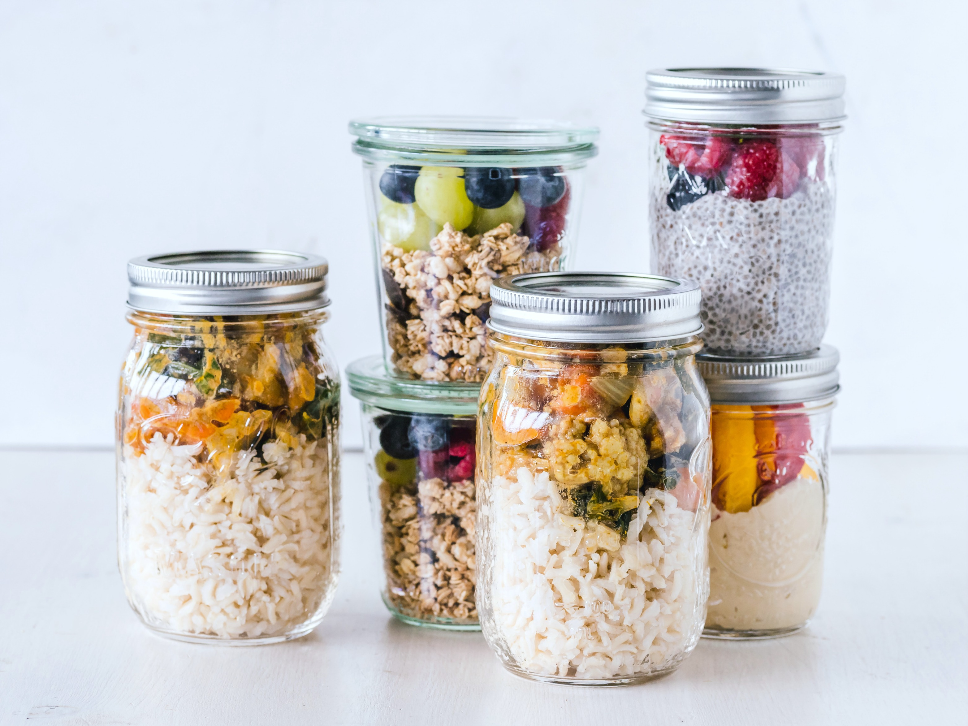 Mason jars filled with prepped food and snacks.