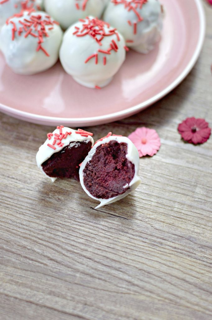 Red velvet truffle is cut in half.