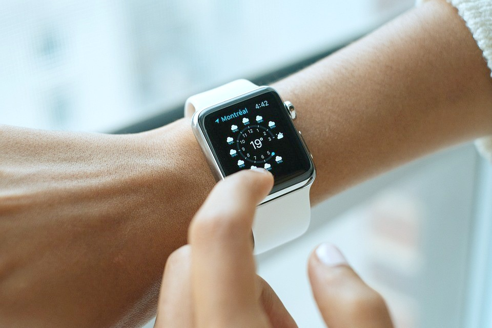 Woman touching her Apple smart watch.