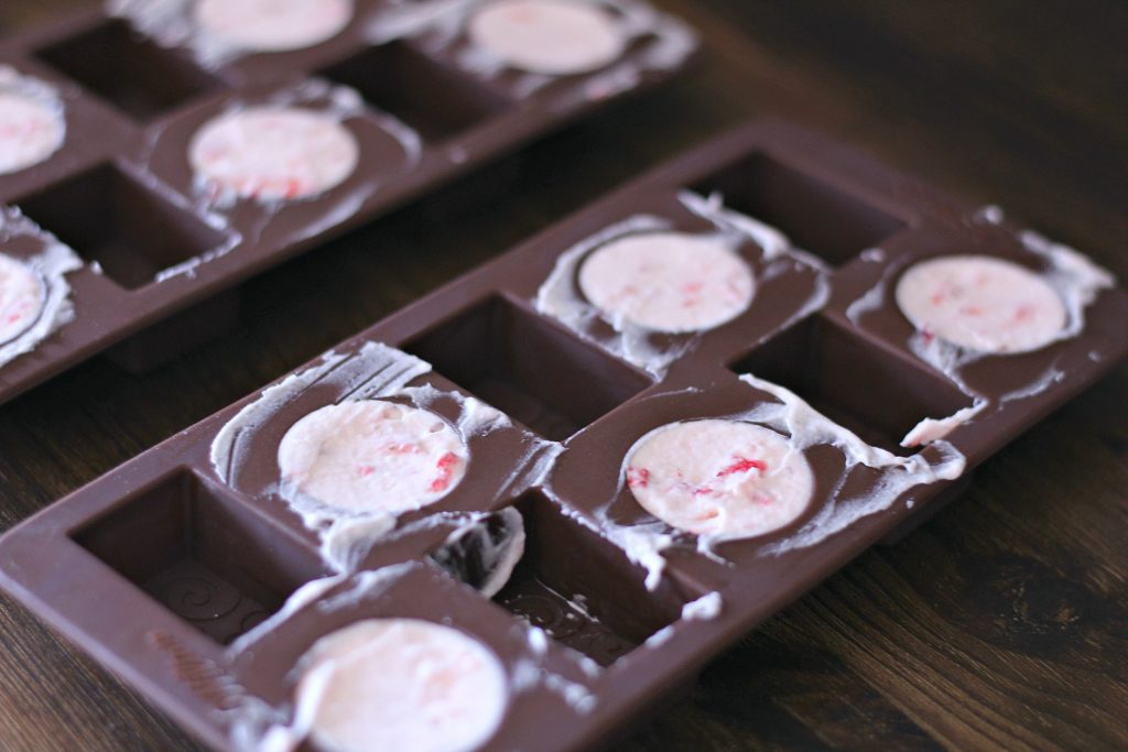 Fat bombs mixture in chocolate molds.