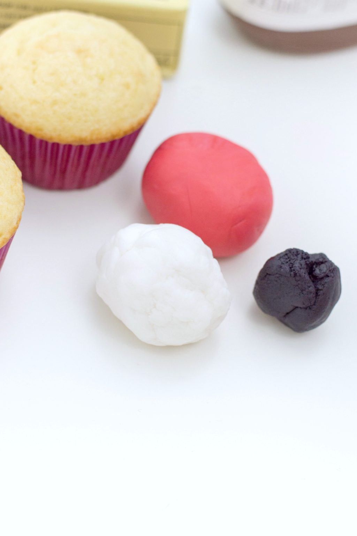 Cupcakes, butter, 3 different colour fondant balls.