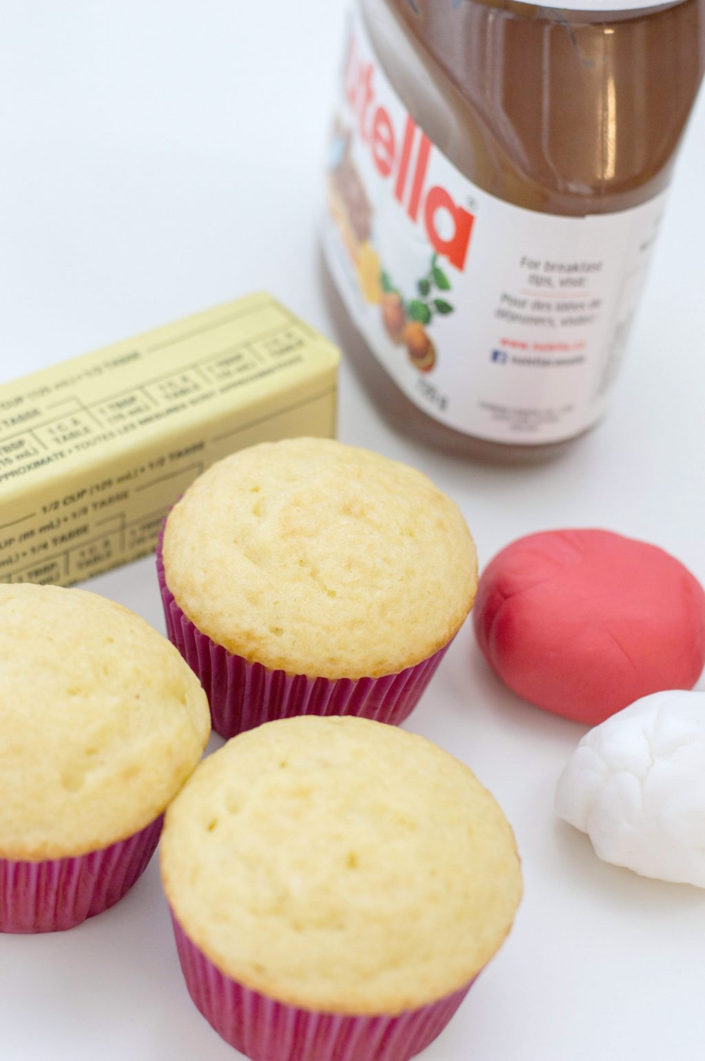 Ingredients, cupcakes, butter, fondant, and Nutella.