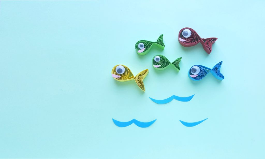 Quilled fish in yellow, gree, blue and red. Inspired by Dr. Seuss One Fish, Two fish, Red Fish, Blue Fish.