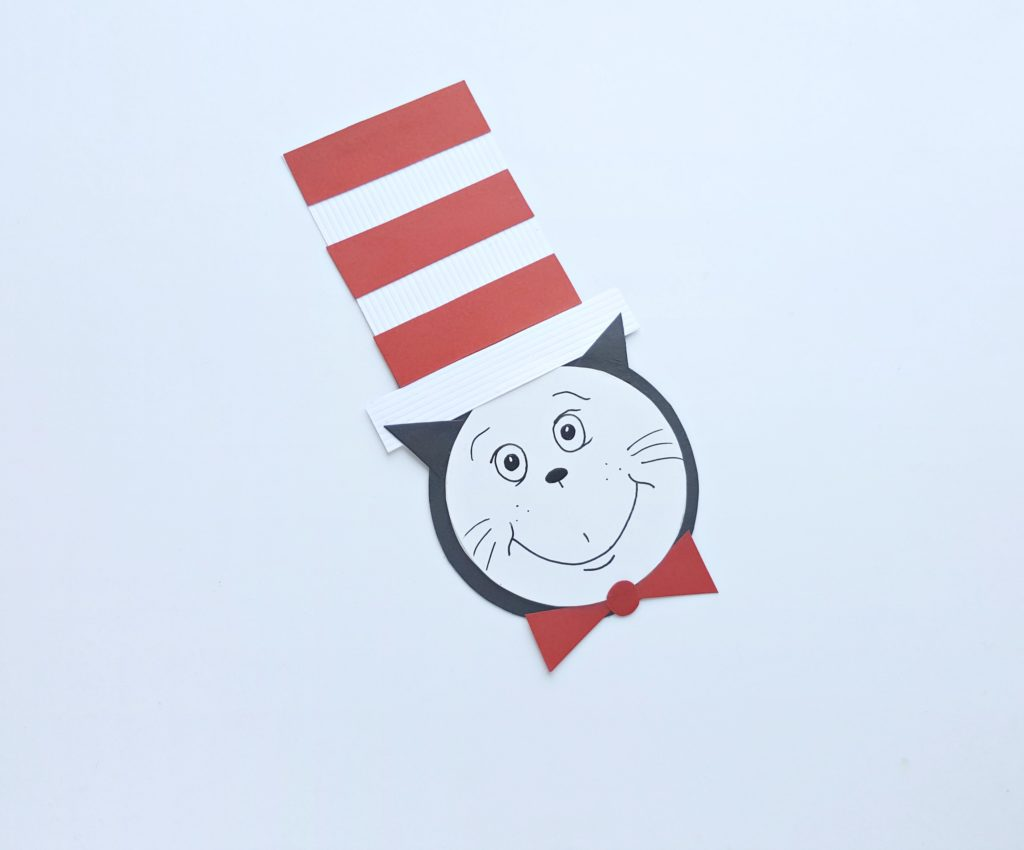 Cat in the Hat's face is drawn on with a black pen.