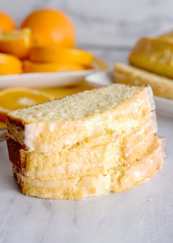 Glazed orange bread sliced and stacked 3 high.