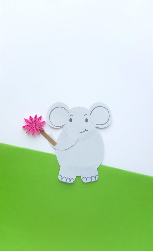 Horton from Horton Hears a Who is on a green and white backround holding a clover.