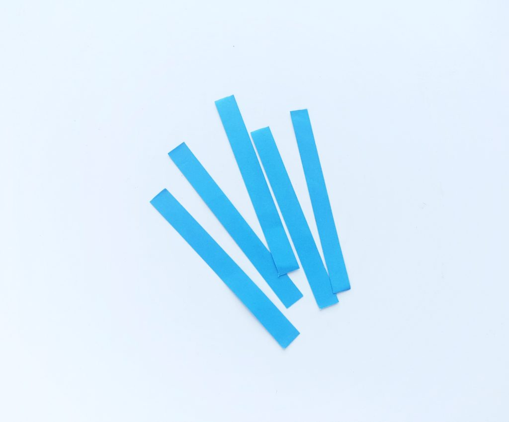 5 strips of blue paper against a white background.