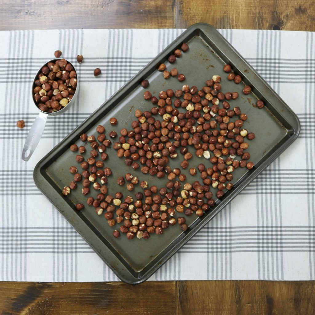 Baking sheet with hazelnuts ready to get roasted.