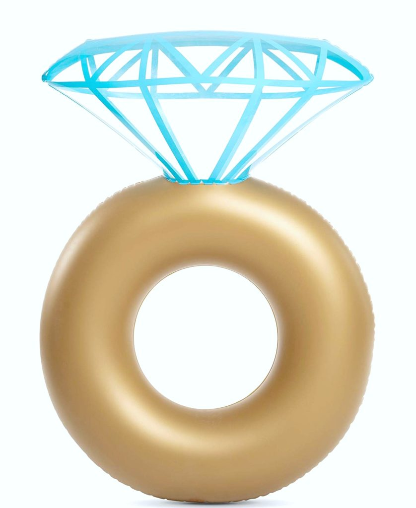 A large diamond ring pool float, gold and and diamond.