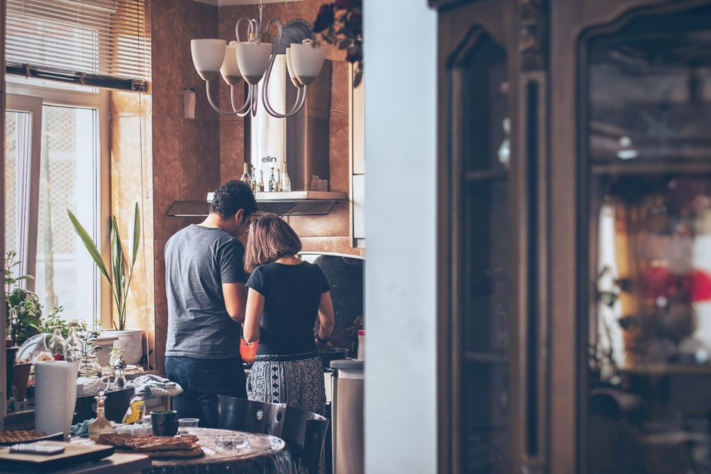 Couple cooking over stove top in a nice and cozy kitchen. Chances are that at least once in your life you'll suffer some degree of a burn. Here is what to do when you burn yourself. #tips