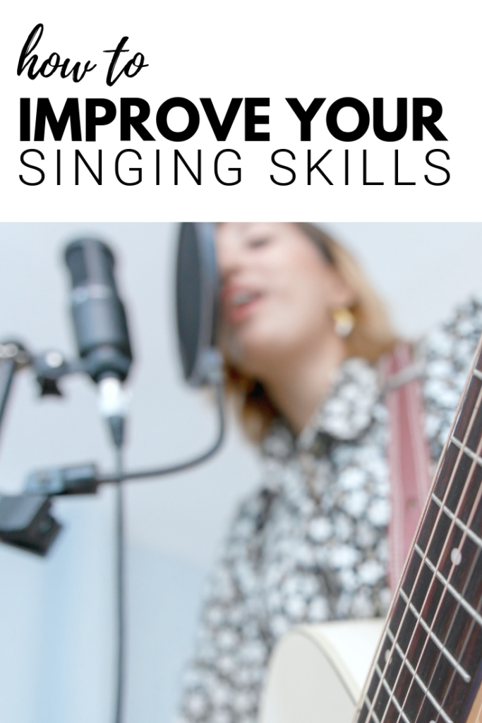 Woman sings into microphone with a guitar a banner above her says 'how to improve your singing skills.'
