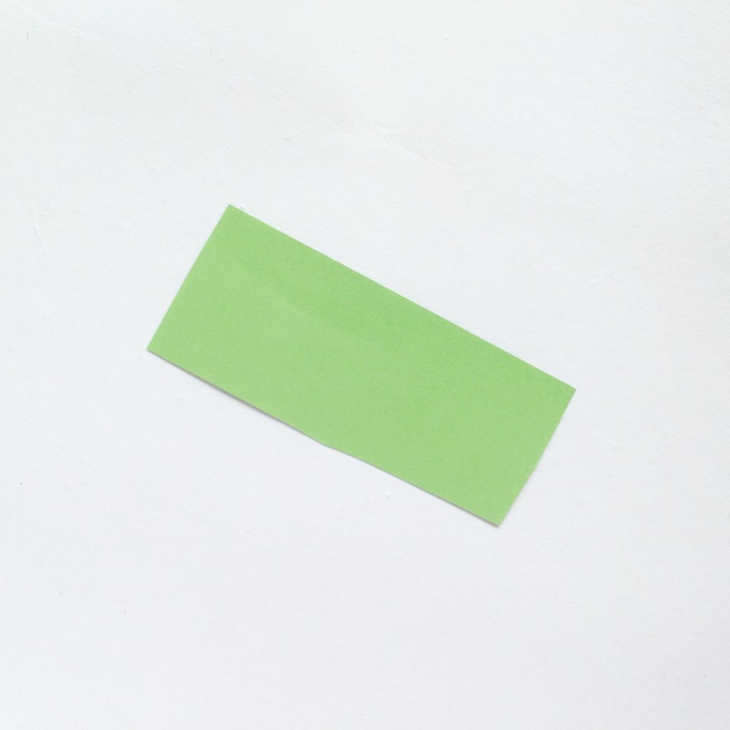 A green rectangle cut out of construction paper.