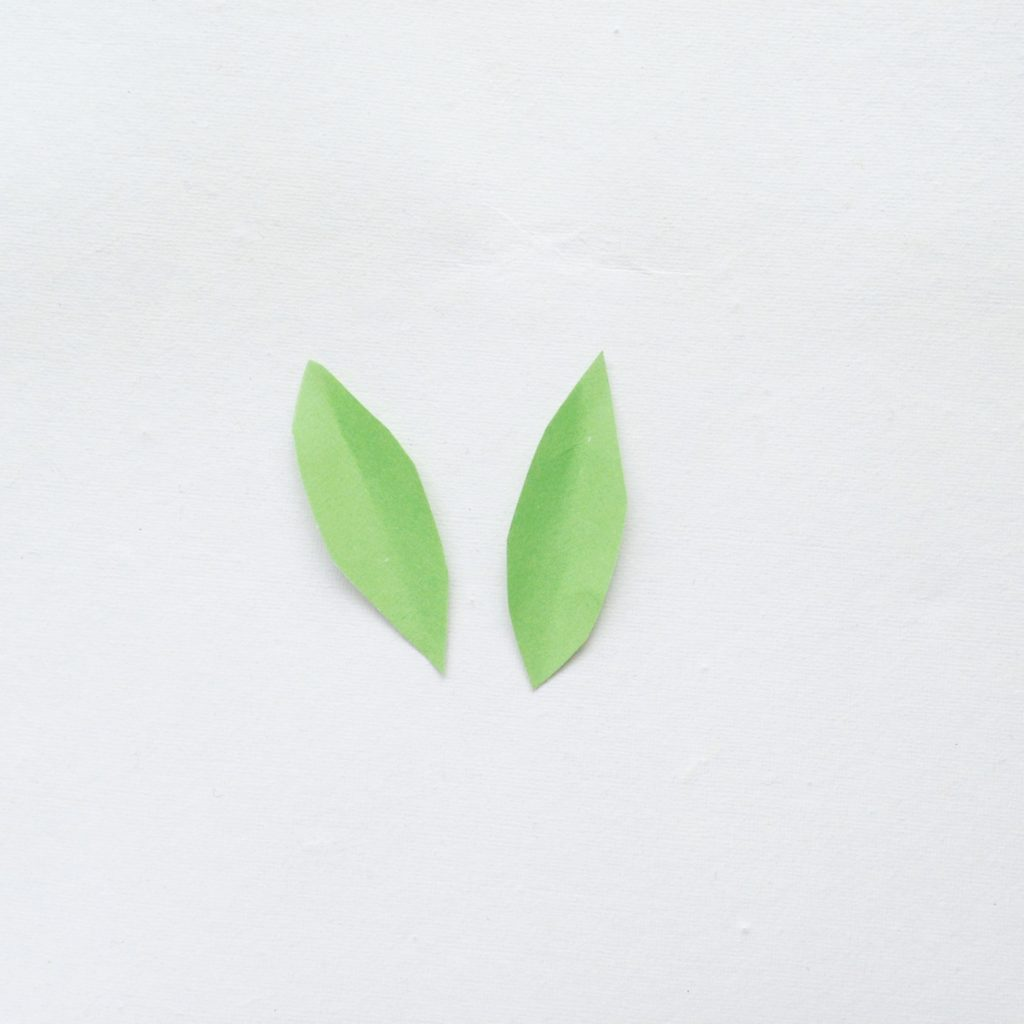 Two leaves cut out of green leaves.