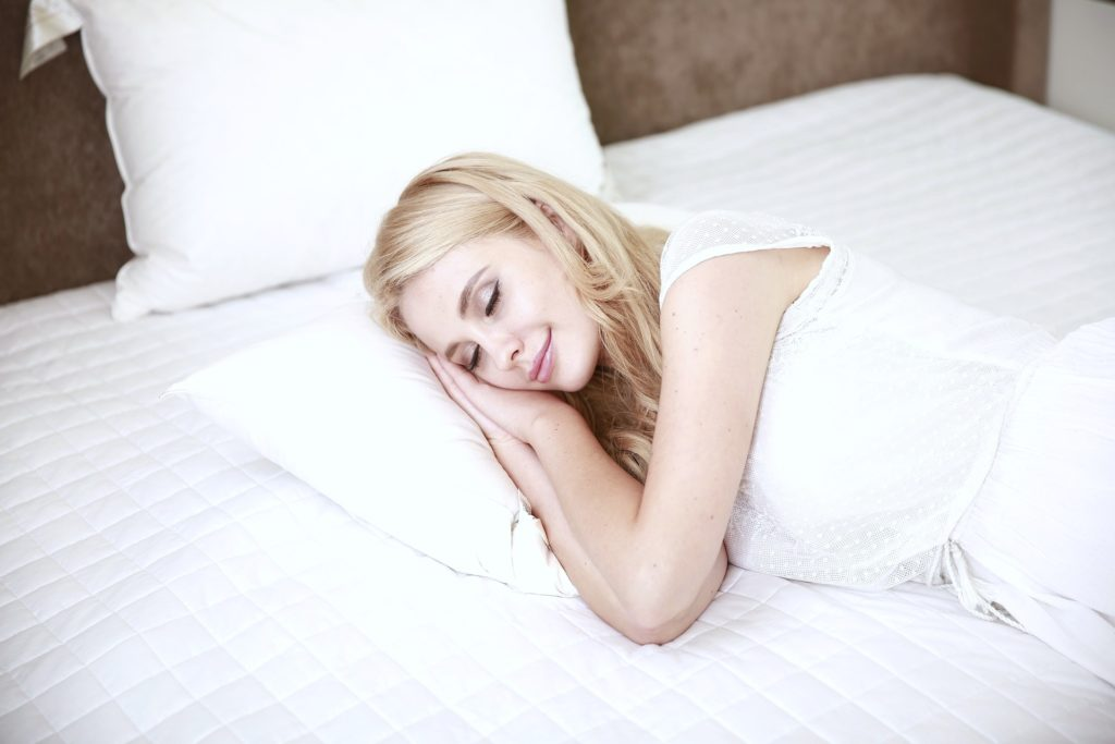 Woman pretends to sleep but, demonstrates the act of sleeping effectively.