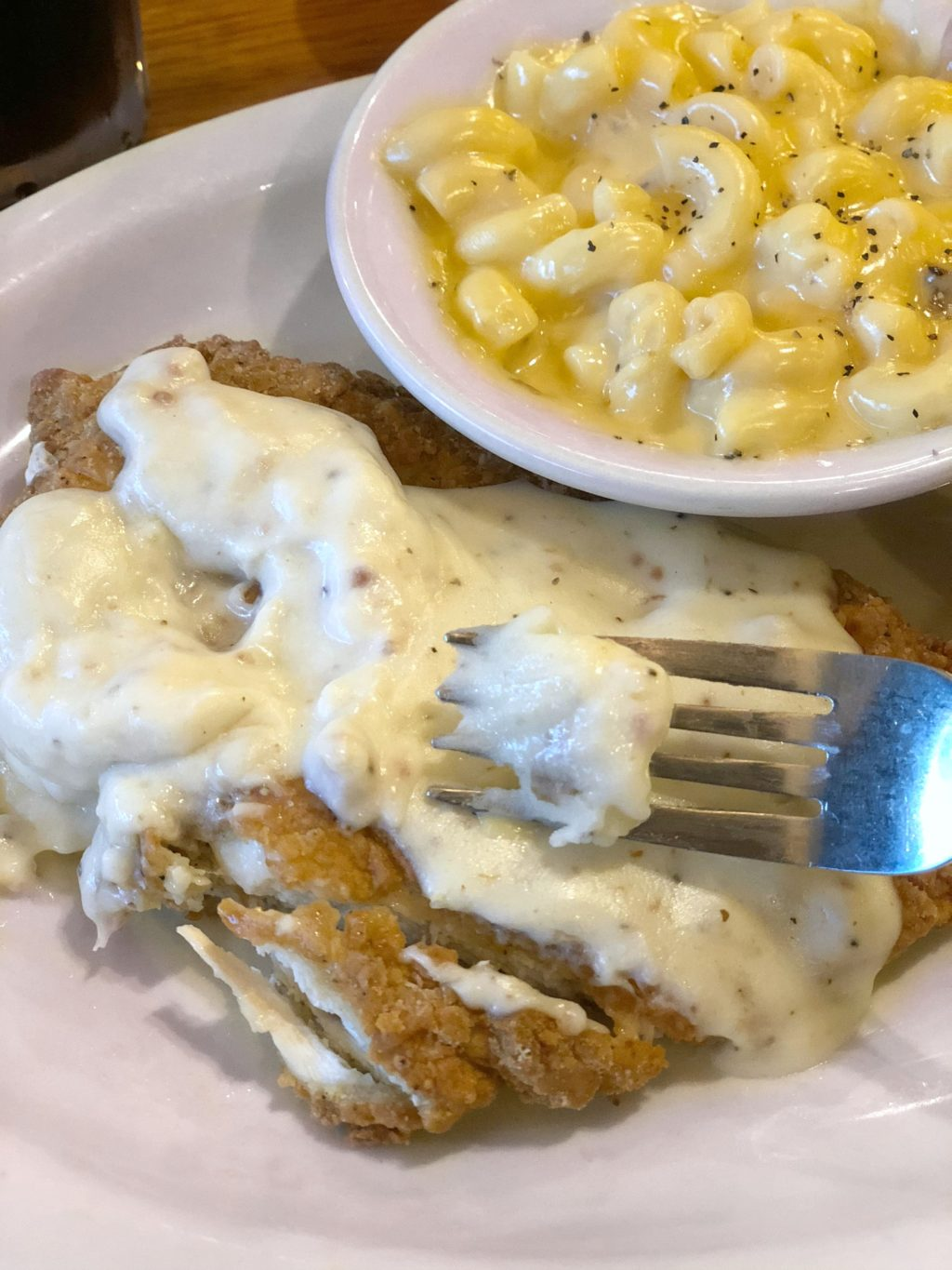 Southern Fried Chicken with mac and cheese and white gravy.