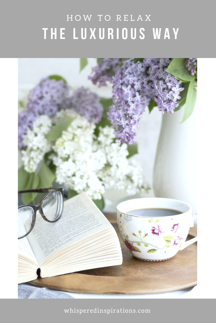 "A banner reads, 'How to Relax the Luxurious Way"" and has a picture of a calm and serene image of a book, glasses, a cup of tea, and fresh flowers."