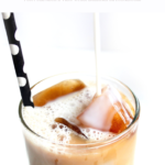 "A delicious vanilla cinnamon iced coffee recipe, close up glass with milk being poured in. A banner reads, ""Vanilla Cinnamon Iced Coffee Recipe, for full recipe visit whisperedinspirations.com""."