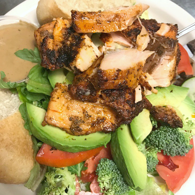 Blackened fish with veggies and bread.