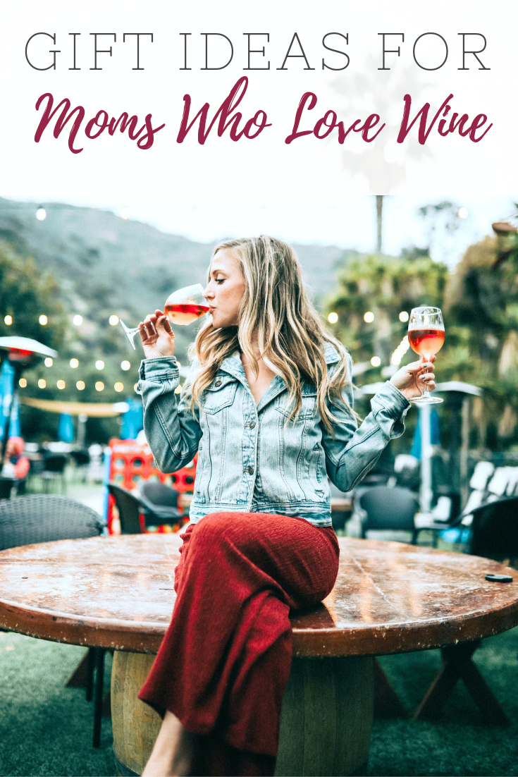 "A banner reads, ""Gift Ideas for Moms Who Love Wine' and it shows a woman drinking a glass of wine, while holding another."