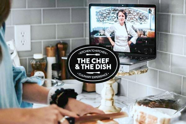 A person cooks while a chef helps them cook a meal via screen.