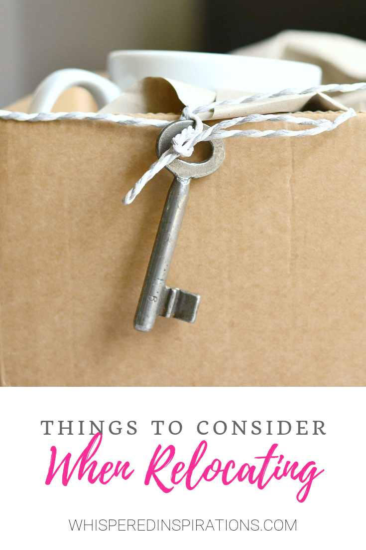 "A picture of a moving box with a mug. A little key hangs on a string. A banner below reads, ""Things to Consider When Relocating""."
