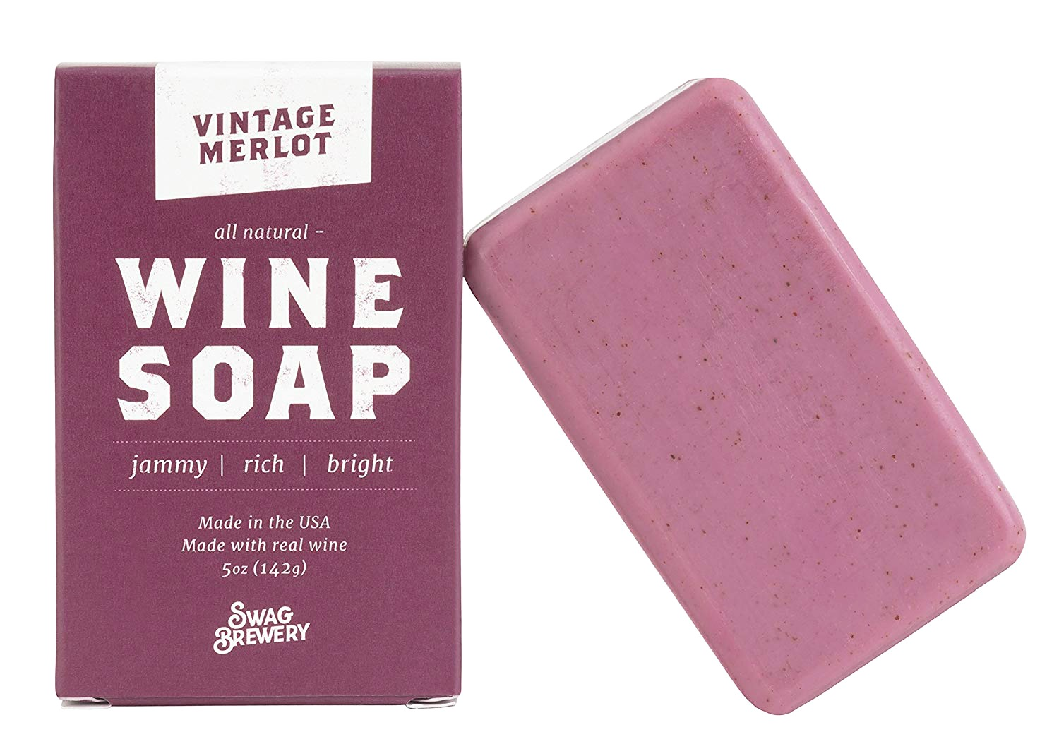 Vintage Merlot, an all natural wine soap is shown leaning on its box that is branded, it's a deep rich, wine coloured soap.