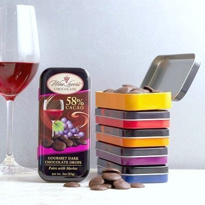 A glass of wine is pictured and next to it, wine infused and flavoured Wine Lovers Chocolate.