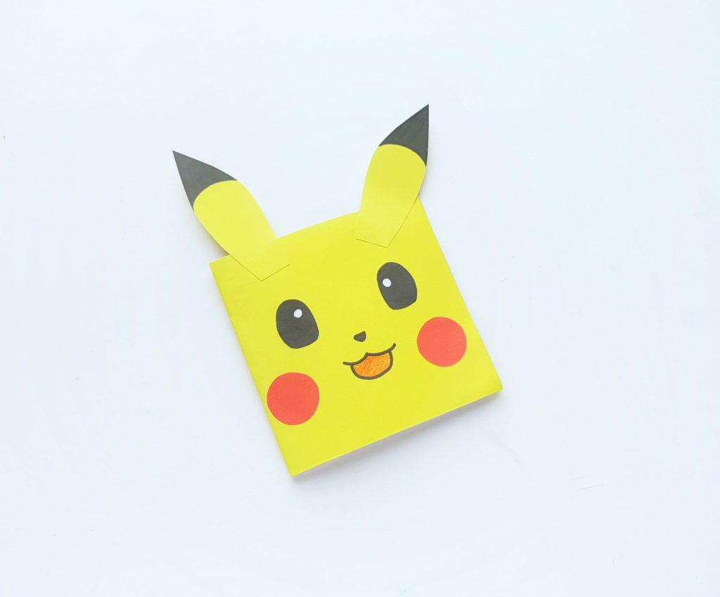 The finished product is a super adorable Pikachu notebook that is ready to be used.