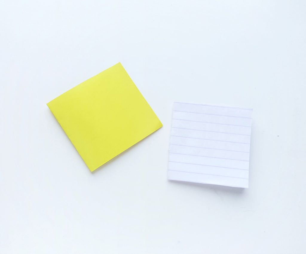 Notebook cover and lined paper are shown.
